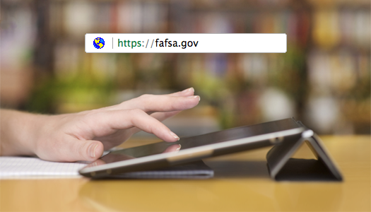 Hand using tablet device with url address bar containing globe and https://fafsa.gov