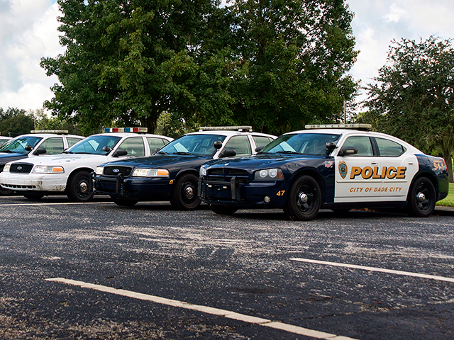 A line of police cars in the parking lot at PHSC East Campus.