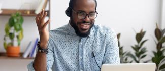 black man wearing headphones and laptop