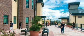 Students walking across the third floor terrace at Porter Campus at Wiregrass Ranch.
