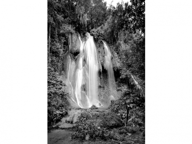 Black and white photography art. Subject is a waterfall.
