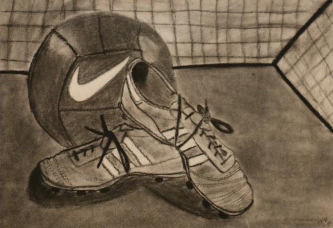 charcoal drawing of Nike brand soccer ball ball and cleats on ground in front of a net
